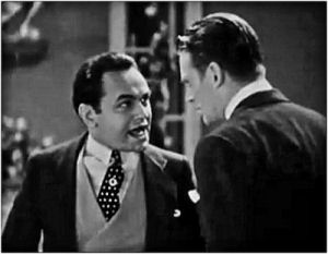 Edward G. Robinson (right) in a cropped screenshot from the trailer for the 1931 film Little Caesar
